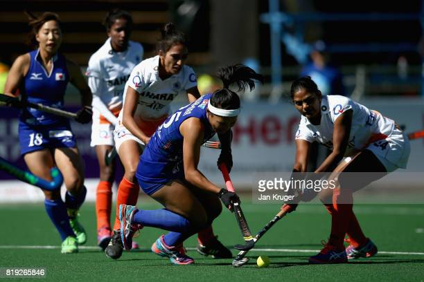 Motomi Kawamura of Japan and Renuka Yadav of India battle for possession during the 5th8th Place playoff match between India and Japan during Day 7...