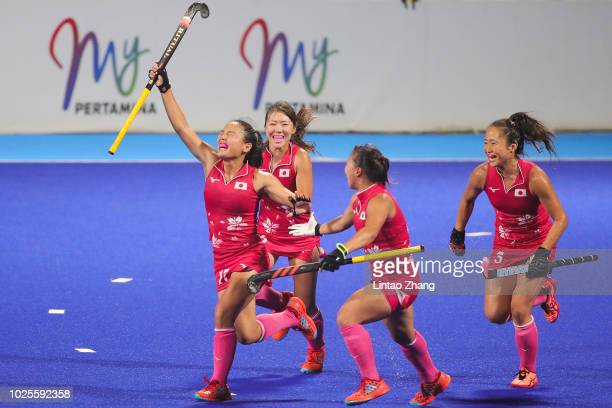 Motomi Kawamura of Japan celebrates her goal with teammate during the Hockey Women's Tournament Final match between Japan and India on day thirteen...