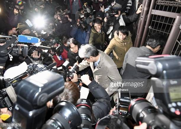 Motonari Otsuru a lawyer representing Carlos Ghosn is surrounded by journalists on Dec 20 outside the Tokyo Detention House where the ousted Nissan...