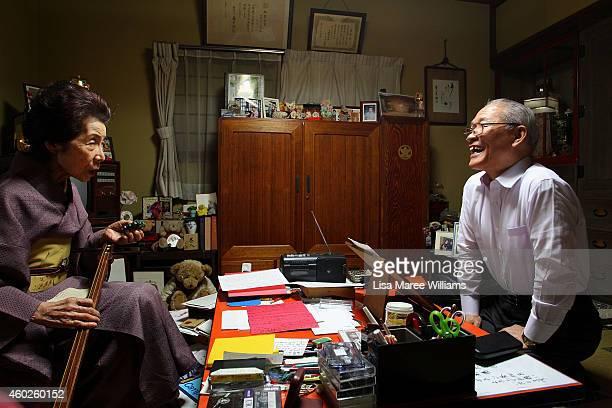 Motoo Takahashi attends singing classes with Geisha Yuko Asakusa at her home studio in the Asakusa District on November 6 2014 in Tokyo Japan 91 year...