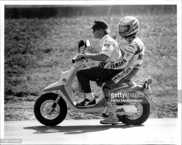 Motor bike Grand Prix practice at Eastern CreekJohn Kocinski is Ridden back to the Pits by an official after injuring his handTragedy The injured...