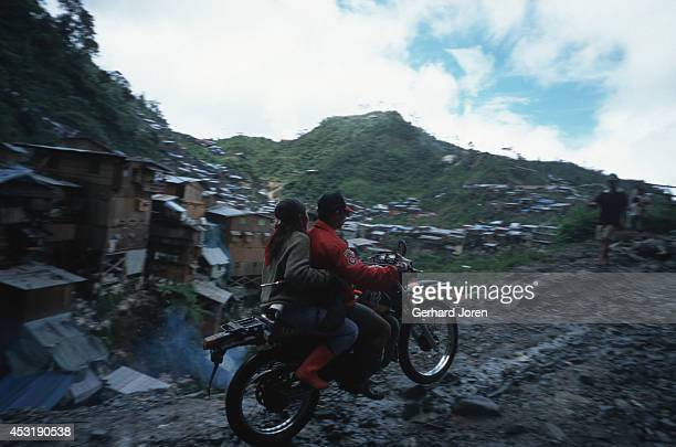 Motor bike taxi is the only mean of transportation in the Diwalwal gold mining community, which is built on stilts along the hill slopes, without any...
