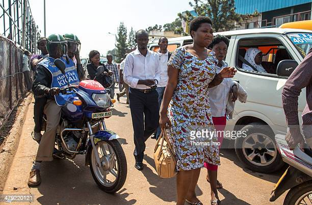 Motor bike taxis and people in the streets of Kigali on February 03 2014 in Kigali Rwanda