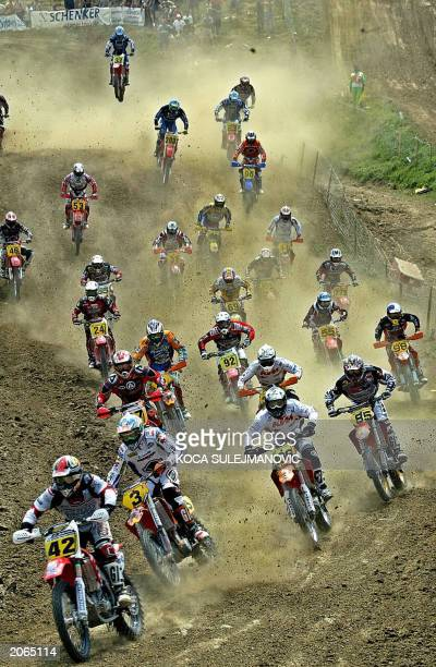 Motor bikers take the first curve after the start of the 650cc Motocross Grand Prix of Bulgaria near the town of Sevlievo 08 June 2003 AFP PHOTO /...
