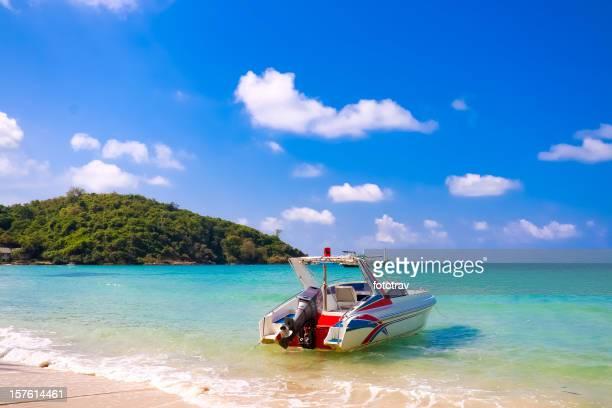 Motor boat at the water's edge on Koh Samet beach, Thailand