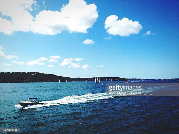 Motor Boat In Blue Sea Against Cloudy Sky During Sunny Day