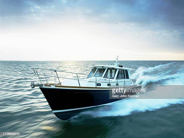 Motor boat powering through the sea