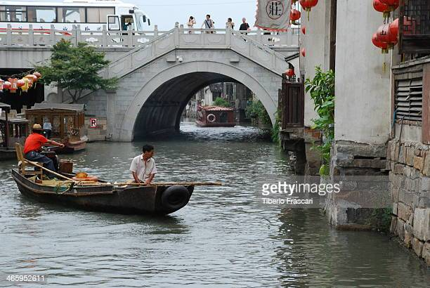 Motor boat sailing in the channels of Suzhou