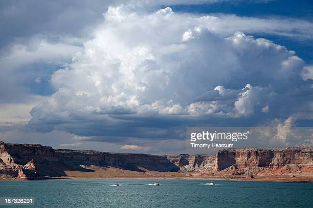 motor boats, jet ski on lake; red mesa, sky beyond - timothy hearsum stock pictures, royalty-free photos & images