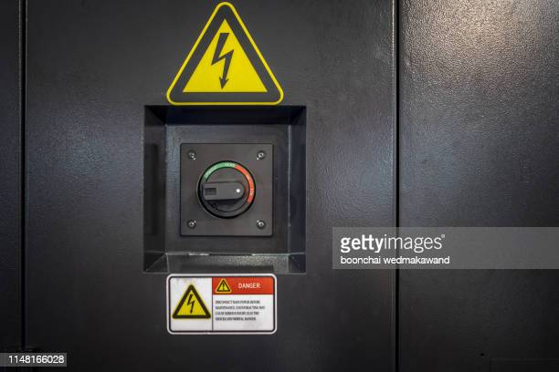 a motor control panel turned off and tagged out with a danger tag. - electrical panel box stock pictures, royalty-free photos & images