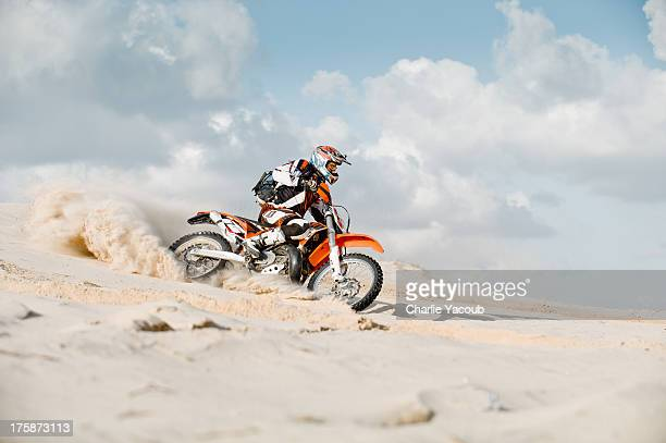 motor cross riding over sand
