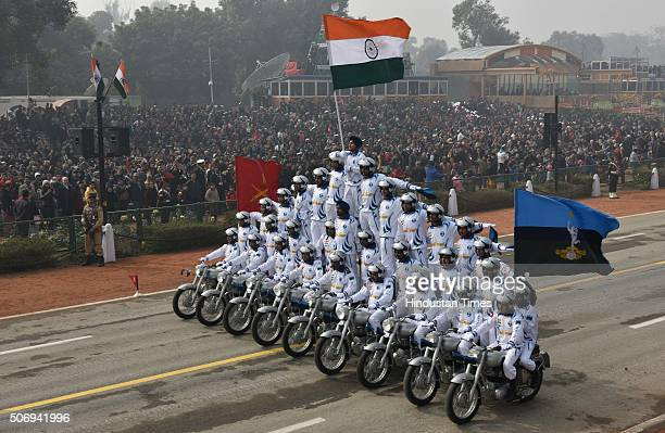 Motor Cycle Display Team 'Dare Devil' of the Corps of Signals roll down in Human Pyramid formation during the Republic Day Parade at Rajpath on...