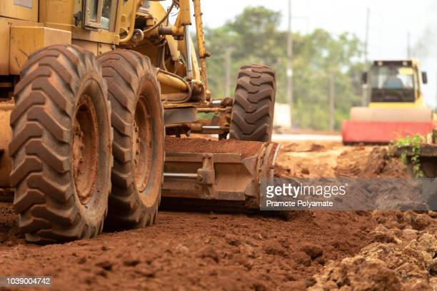 motor grader civil construction improvement base road work, motor grader civil construction - ancient civilisation stock pictures, royalty-free photos & images