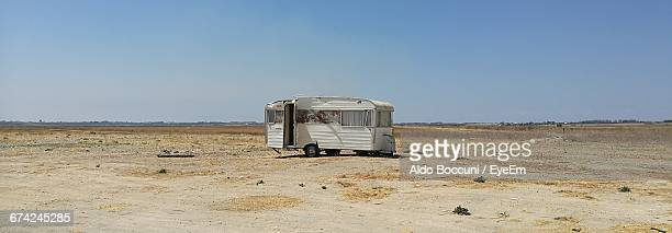 Motor Home On Field Against Clear Sky