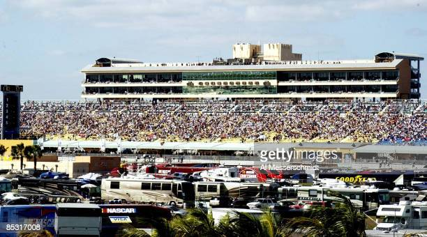 Motor homes fill the infield and fans fill the stands for the start Saturday November 15 2003 of the Busch Series Ford 300 NASCAR race at...