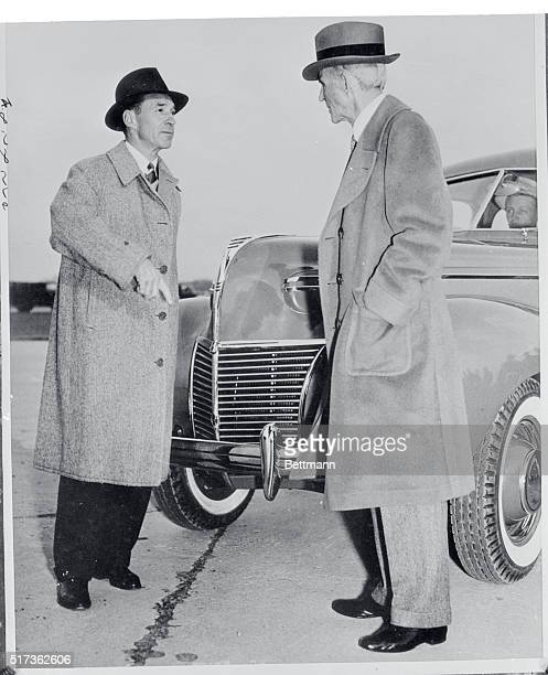 """Motor king Henry Ford and son Edsel do a """"salesman and prospect"""" act during unveiling of the 1939 models at the Ford factory. With Edsel apparently..."""