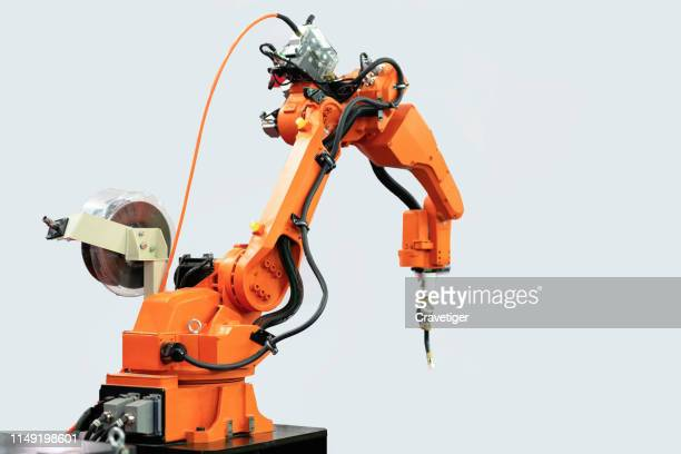 motor of robotic arm on isolated background. mechanical hand. industrial robot manipulator. modern industrial technology.welding concept. - robotic arm stock pictures, royalty-free photos & images