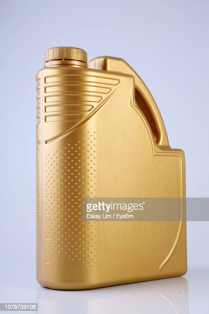 motor oil bottle over white background - motor oil stock pictures, royalty-free photos & images