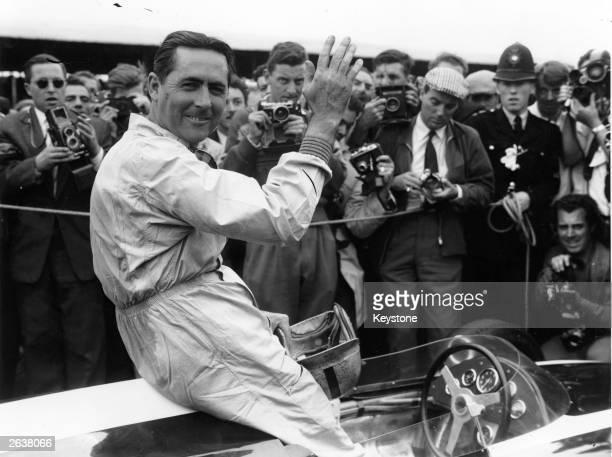 Motor racing champion Sir Jack Brabham surrounded by photographers