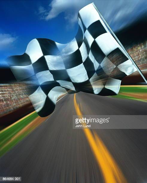 Motor racing, chequered flag above track (Digital Composite)