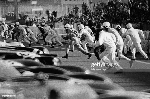 Motor racing drivers run to their cars at the start of the 1973 Le Mans 24 hour race | Location Near Le Mans France