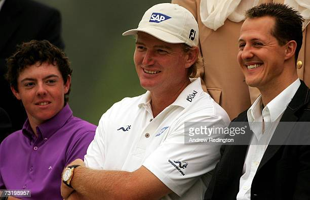 Motor racing great Michael Schumacher jokes with Ernie Els of South Africa and Rory McIlroy of Northern Ireland (left at the prize-giving for the...