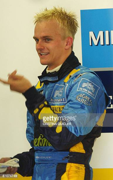 Motor racing junior driver Finnish Heikki Kovalainen of Renault's team gets ready for training at Jerez's circuit, 16 July 2004. AFP PHOTO/ Cristina...