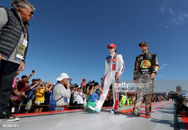 Motor racing legend Mario Andretti Ryan Blaney driver of the Motorcraft/Quick Lane Tire Auto Center Ford and Martin Truex Jr driver of the Bass Pro...