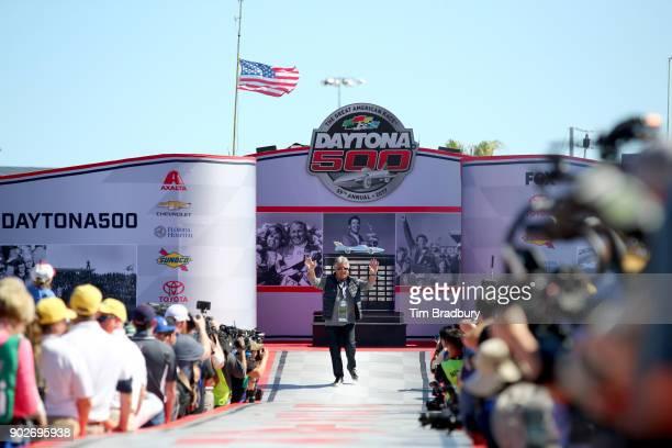 Motor racing legend Mario Andretti walks the driver's intros before 59th Annual DAYTONA 500 at Daytona International Speedway on February 26 2017 in...
