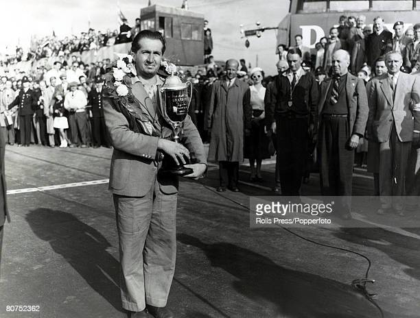 19th July 1951 Italian motor racing ace Alberto Ascari pictured after winning the British Grand Prix at Silverstone He won in a Ferrari with an...