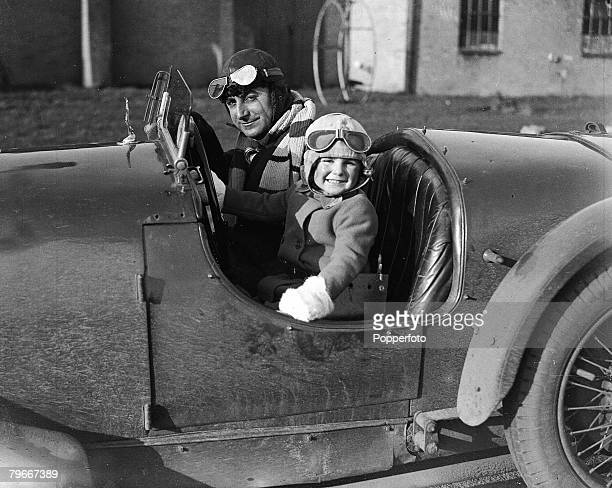 Motor racing Surrey England 12th January Airman and racing motorist Captain Dennis Shipwright with his two year old daughter Wendy at the wheel of...