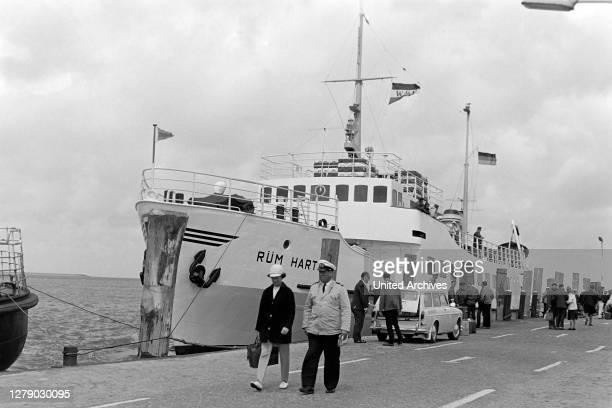 """Motor ship """"Ruem Hart"""" at Wyk harbor on Foehr island, Germany 1960s."""