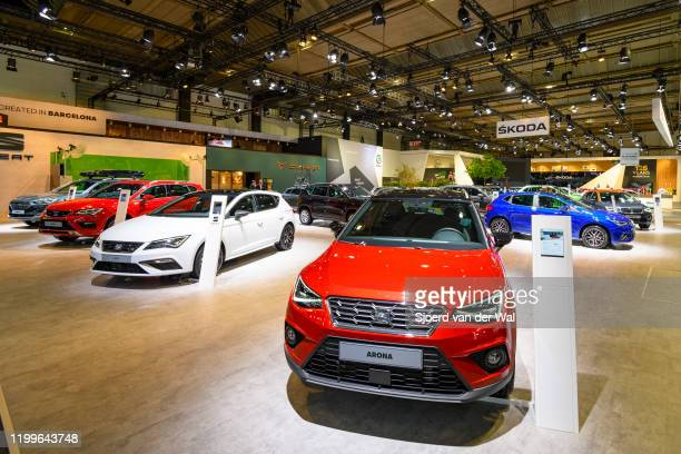 SEAT motor show stand with the Seat Arona and Seat Leon hatchback cars in the foreground on display at Brussels Expo on January 9 2020 in Brussels...