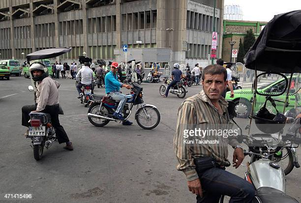 Motor taxis on the street in the capital city Tehran Iran on June 12 2014 Comprehensive nuclear agreement between Iran and world powers including the...