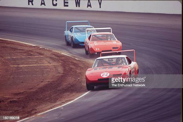 Motor Trend 500 NASCAR Riverside Bobby Allison Bobby Isaac both driving Dodge Daytona's and Richard Petty in his Plymouth Superbird battle it out
