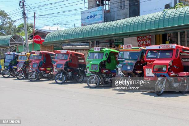Motor tricycles for hire lined up, Tagbilaran City, Bohol