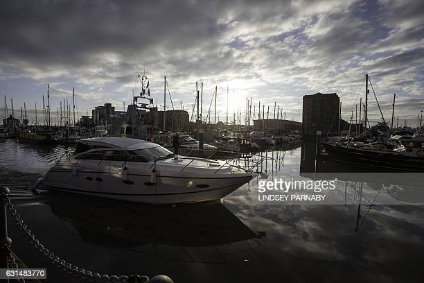 Motor yacht sails into the marina in Hull, northern England on January 8, 2017. Hull is the UK City of Culture 2017 and will host a year-long...