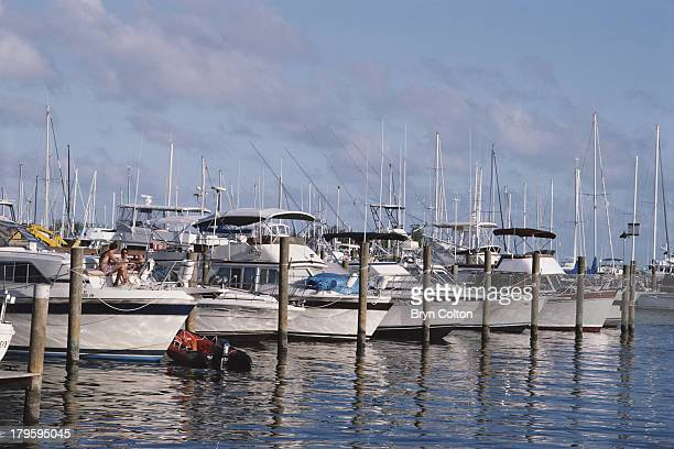 Motor yachts lie moored to the quayside in the harbour at Key Largo in the Florida Keys United States in 1993