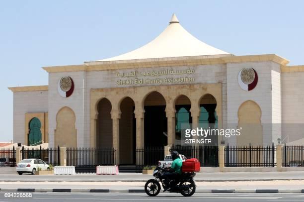 A motorbike drives past the Sheikh Eid Charity Association in the Qatari capital Doha on June 9 2017 Saudi Arabia Egypt the UAE and Bahrain announced...