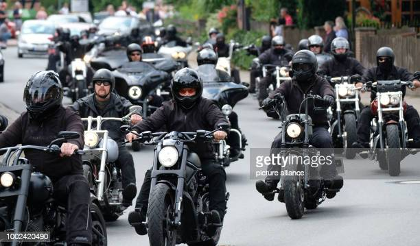 A motorbike escort accompanies the limousine of the wedding couple after the wedding of Hells Angels boss Hanebuth through the town of Bissendorf...