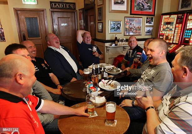 Motorbike fans from Pontefract in Yorkshire drink in a local pub after torrential rain prevented the anual TT superbike races taking place on June 6...