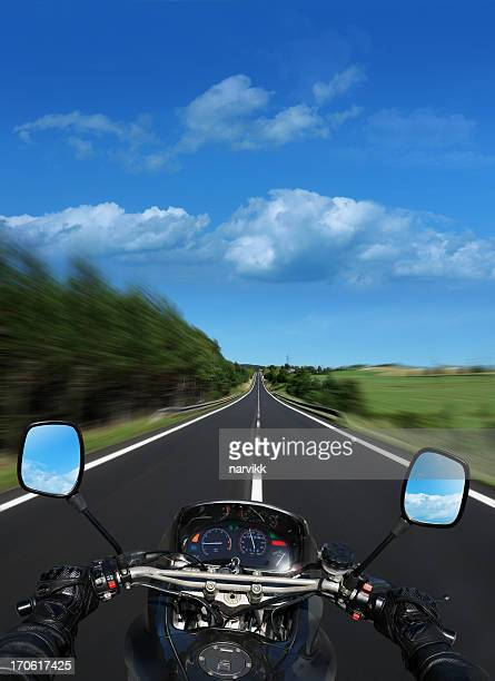 motorbike going fast on the straight road - handlebar stock photos and pictures