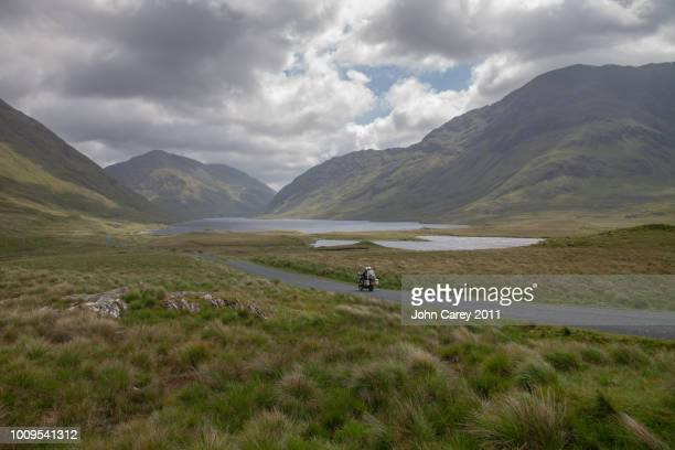 motorbike going through doolough valley, co mayo - famine stock pictures, royalty-free photos & images