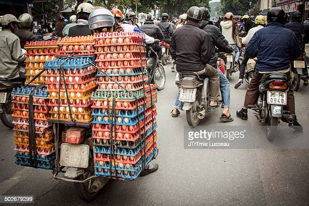 Motorbike loaded with eggs in a traffic jam.