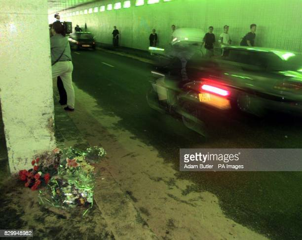 A motorbike passes the point of the fatal car accident in Paris last night which killed Diana Princess of Wales and her friend Dodi Fayed Bunches of...