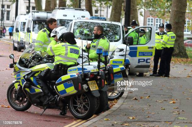 Motorbike policemen are parked up awaiting a call to action. With a number of expected demonstrations taking place in the capital this weekend, the...