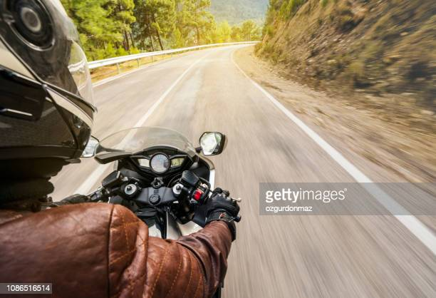 motorbike ride on a country road - riding stock pictures, royalty-free photos & images