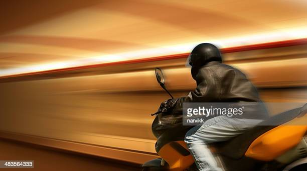 motorbike rider in motion - motorcycle racing stock pictures, royalty-free photos & images