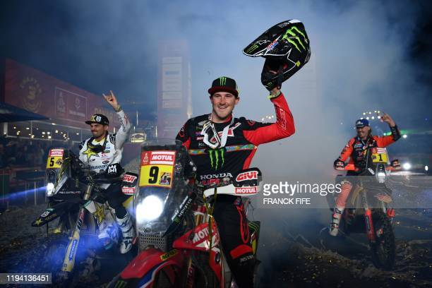 Motorbike riders Chile's Pablo Quintanilla, US Ricky Brabec and Australia's Toby Price celebrate after the end of Dakar 2020 in Qiddiya on January...