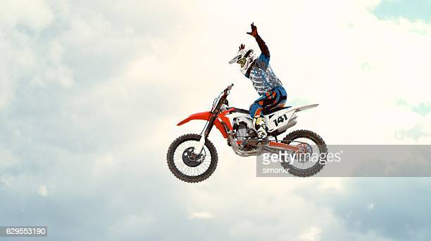 motorbike riding - stunt stock photos and pictures
